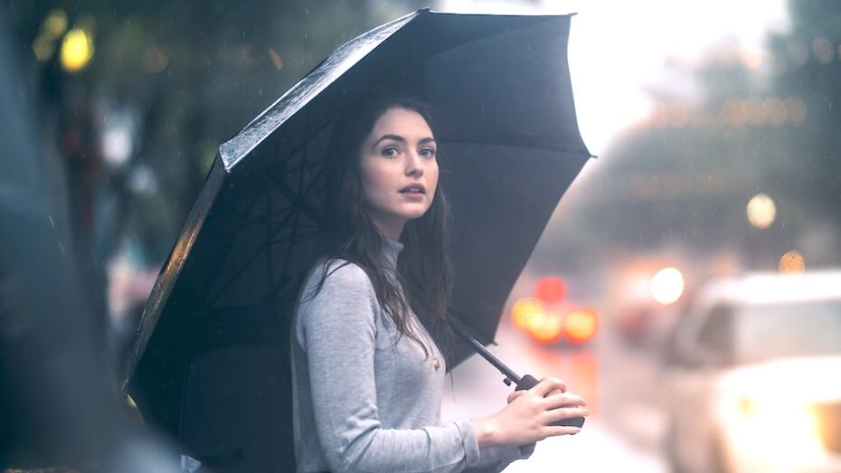 This image has an empty alt attribute; its file name is unsplash-jon-ly-woman-waiting-in-rain-with-umbrella-111219.jpg